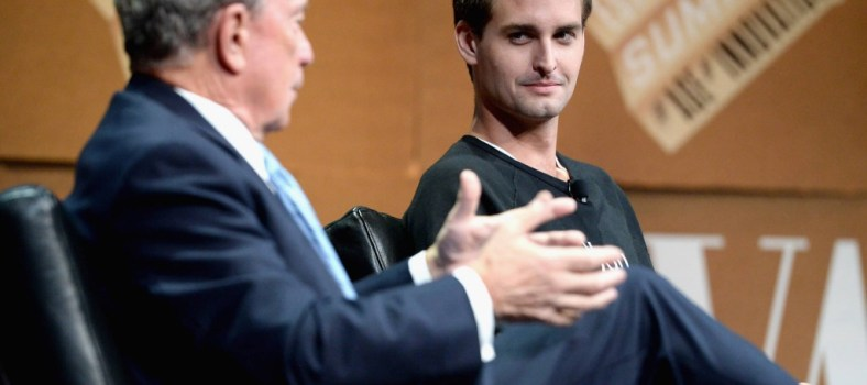 Spiegel listens as fellow media maven Michael Bloomberg speaks   Vanity Fair