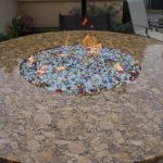 """The fire pit features a 22"" fire ring and glass from Fire Crystals.com."""