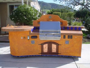"Features; custom IPE doors with copper panels, Alpine Marine Deck and speakers, fire pit with Fire Crystals.com, custom deco tiles and water feature. The bbq featured is a 30"" PGS natural gas grill. This island features casters under the frame for mobility as well."