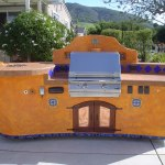 """Features; custom IPE doors with copper panels, Alpine Marine Deck and speakers, fire pit with Fire Crystals.com, custom deco tiles and water feature. The bbq featured is a 30"""" PGS natural gas grill. This island features casters under the frame for mobility as well."""