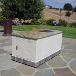 "Outdoor fire pit w/ propane storage and granite counter top. ""This fire pit was built on casters for mobility."""