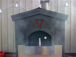 """This oven was designed to fit the 'V Vega Winery' this fabricated design was the first of its time""."