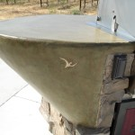 The bbq sits in a concrete sculpted counter top that has a concrete stain foe finish.