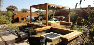Custom contemporary outdoor kitchen, fiire pits, & outdoor living area.