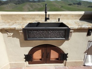 "30"" Bronze Farm Sink with custom Cypress Doors with copper inlay, and custom hinges."