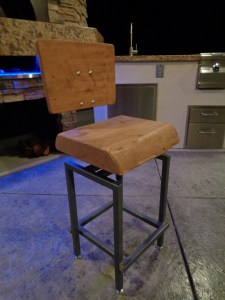 "These custom stools feature a powder coated steel frame. A solid 3"" thick Cypress seat and 1"" back. The seat has a 6"" height adjustment along with adjustable feet."