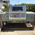 This Contemporary Outdoor Kitchen was designed and built by Leasure Concepts. The kitchen was designed to with stand the elements of coast line with its stainless steel powder coated frame and finishes.
