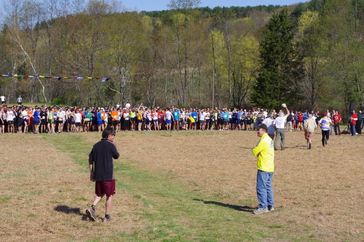 Starting line of 25th Loop in 2011. Race founders Ken Littlefield, Tony Godino, Pete Thompson, and Dave Cope wave to runners. Bill Bradsell (maroon shorts) and Jim Gerweck (yellow shirt) are in foreground.