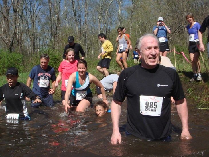 Runners at Sullivan's Surprise - mid-point of race water crossing. Water can get deep here and bank is slippery.
