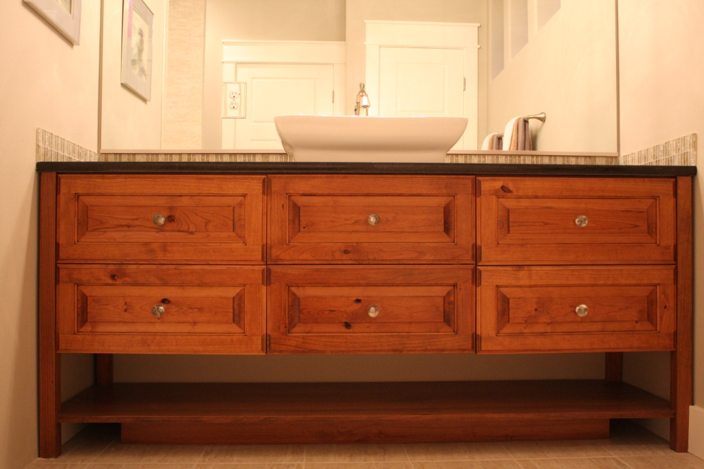 Custom bathroom vanity made from Cherry wood. Installed in Kennewick, WA. Designed and built by Legacy Mill & Cabinet. Visit our showrooms in the Tri Cities, WA and North Salt Lake, UT.