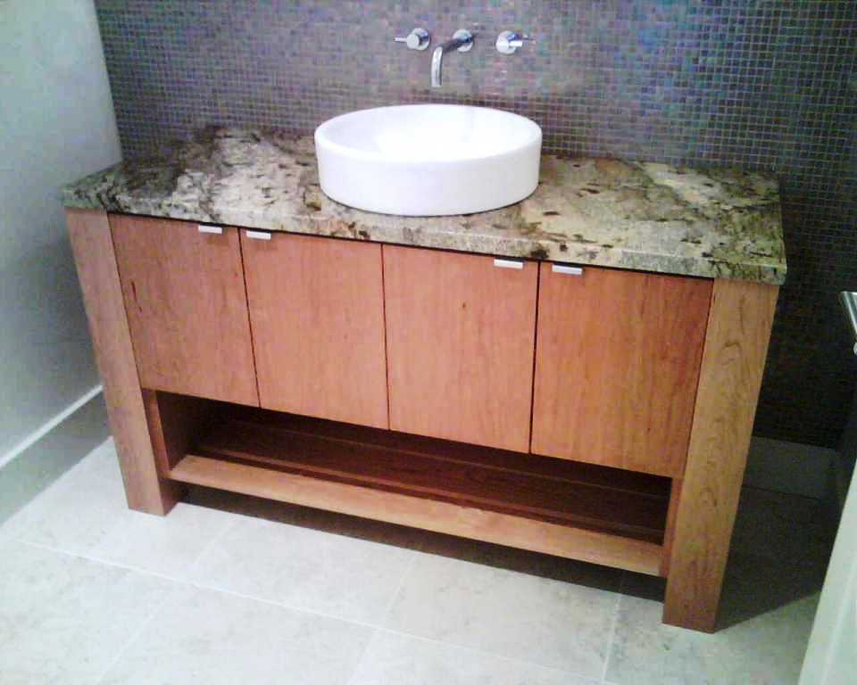 Contemporary bathroom vanity cabinetry. Designed and manufactured by Legacy Mill & Cabinet LLC. Cabinet showrooms located in North Salt Lake, UT and Richland, WA.
