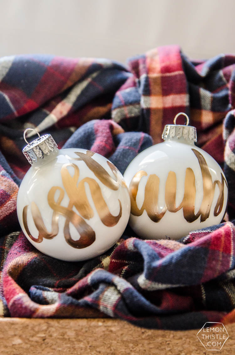DIY Hand Lettered Ornaments- these would make great gifts for Christmas with the person's name!