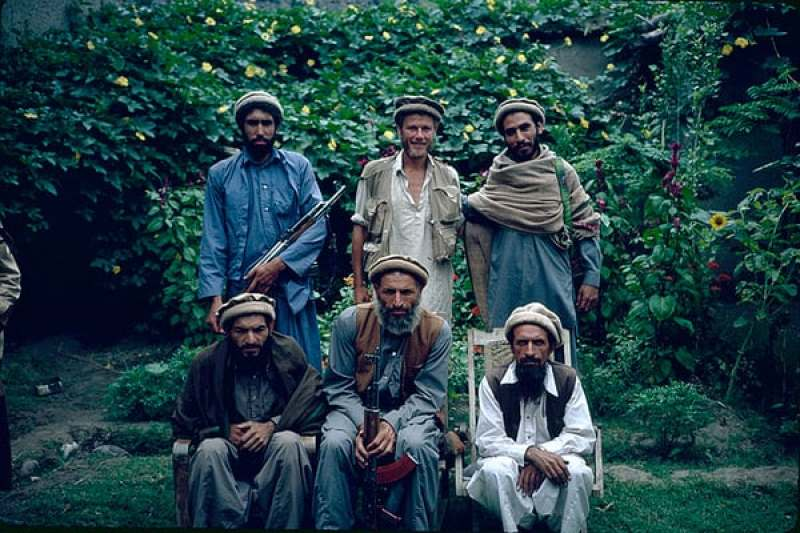 Edward Girardet (rear, center) stands with guerrilla commanders in Afghanistan's while working as a reporter in 1979 - copyright Edward Girardet