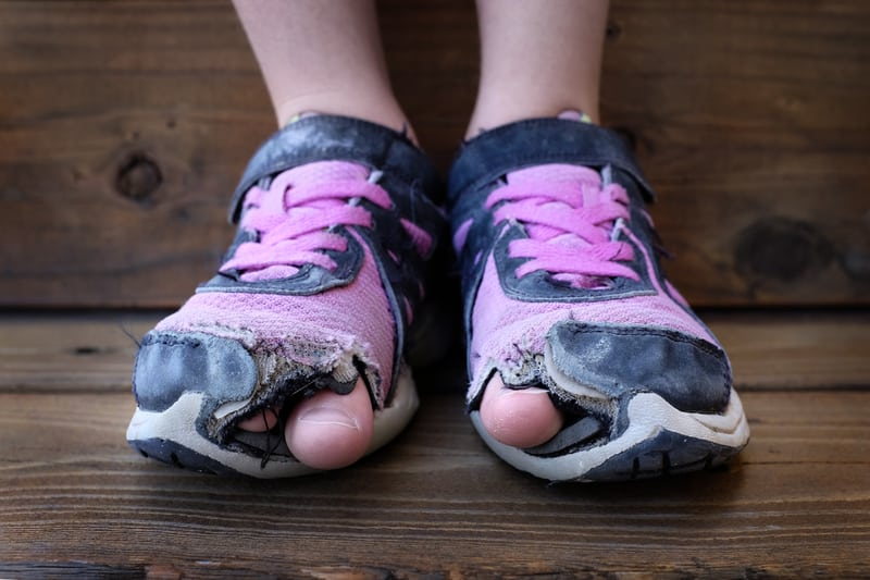 0.5% of Swiss kids don't have two pairs of shoes in good condition - © Lane Erickson | Dreamstime.com