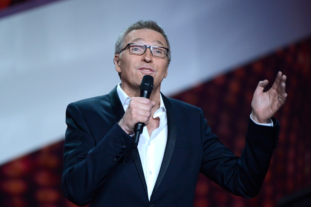 French TV host and Master of Ceremony, Laurent Ruquier speaks during the 28th Victoires de la Musique, the annual French music awards ceremony, on February 8, 2013 at the Zenith concert hall in Paris.  AFP PHOTO / BERTRAND GUAY