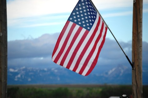 A flag flies at the gate to Anderson Ranch, just west of Dupuyer