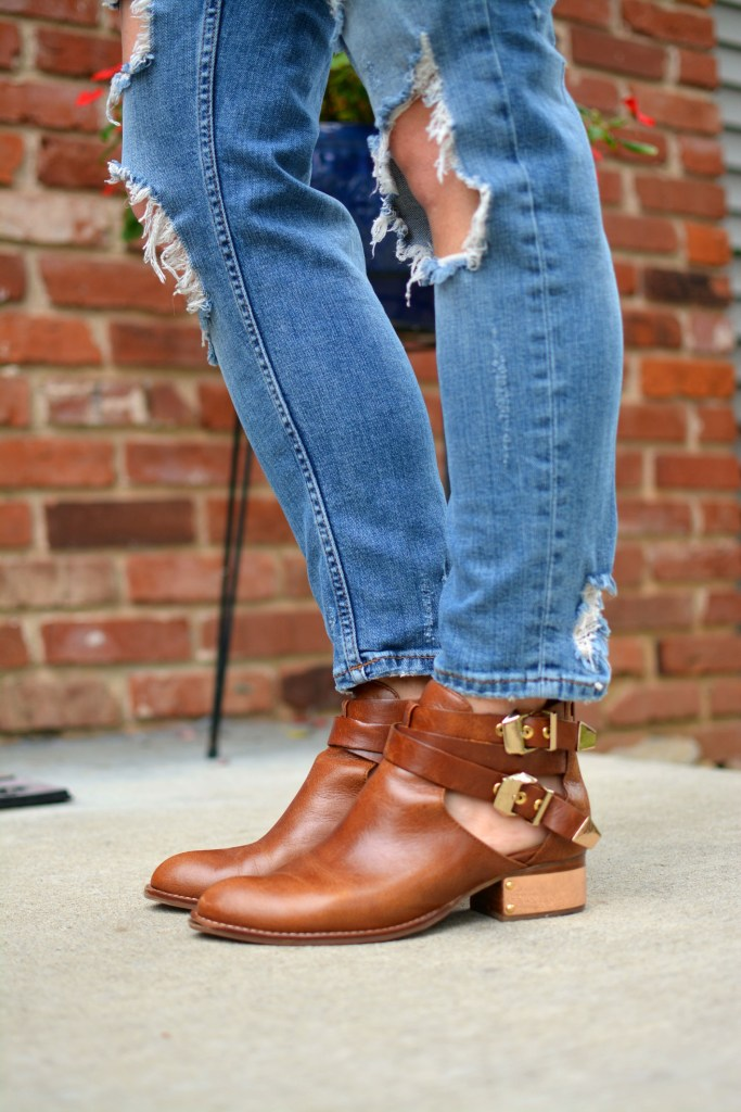 ashley from lsr in ripped jeans and ankle booties