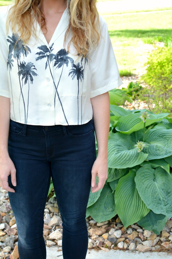 Ashley from LSR in a palm tree crop top and Frame jeans