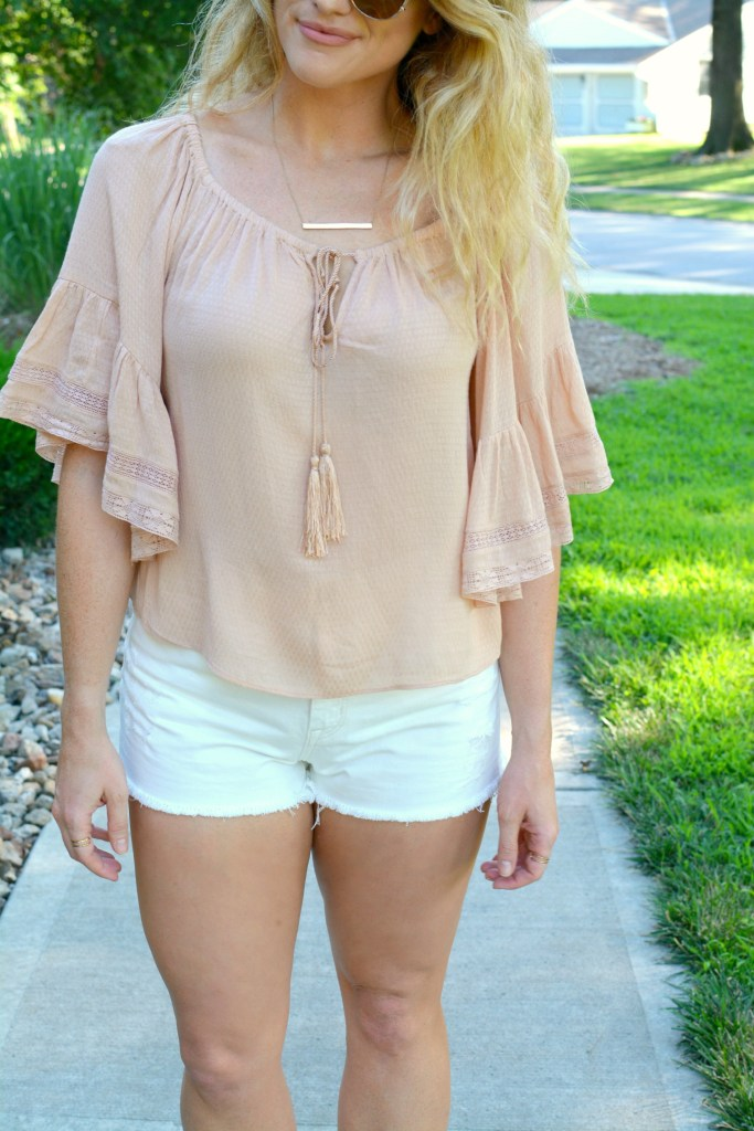 Ashley from LSR in a blush top from Zara and white denim shorts