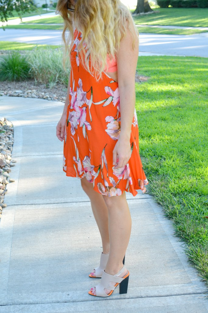 Ashley from LSR in an orange Minkpink dress and mule sandals