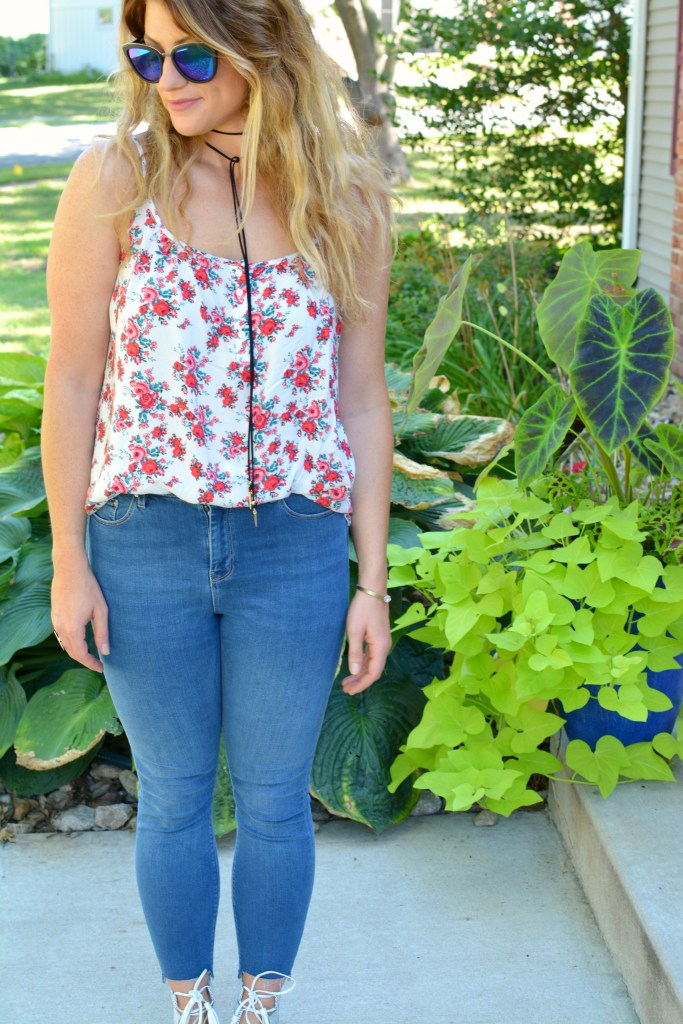 Ashley from LSR in a floral tank, Diff sunglasses, and a Vanessa Mooney choker