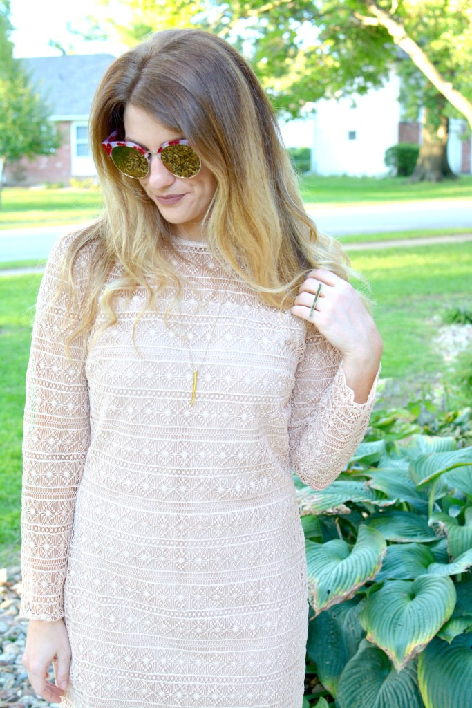 Ashley from LSR in a nude lace dress and over-sized sunglasses