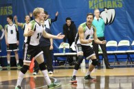 Dax Whitehead and Tim Taylor celebrate after taking  a point in their win against the Olds College Broncos at the Val Matteotti gym on Oct. 23, 2015.