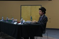 Solomon Krygier-Paine warming up his vocal cords before a political forum