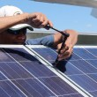 Chris Crow Shoe installing solar panels on the Piikani Nation reserve