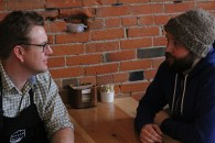 Leeroy Stagger (left) chats with local business owner, Michael Knipe, who's establishment, Bread Milk and Honey purchased some of Stagger's furniture line, Hatch & Thicket.