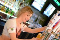 Sarah Yanciw, server at the the Tilted Kilt, pouring a cold beverage for one of the guests on the last day of February.
