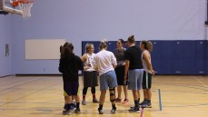 New head coach, Deanna Dotts, discusses practice with the team in the Val Matteotti gym, Oct 3.
