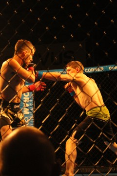 Justin Grey takes a swing at Jesse Richardson at Rumble in the Cage 55 in Lethbridge, AB on Spetember 30.
