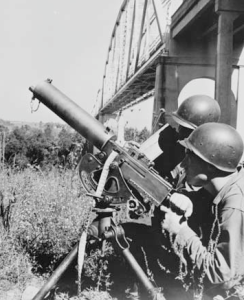 Machine gun crew guard bridge during Tennessee Maneuvers