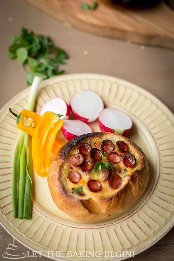 Egg and Sausage Stuffed Breakfast Boats  - an easy-peasy breakfast that is filled with all things delicious – cheese, sausage and egg. By LetTheBakingBeginBlog.com | @Letthebakingbgn