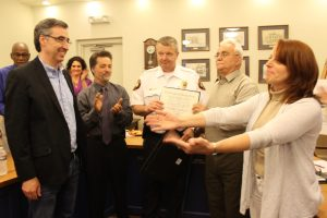 Phil Sheridan (left) as Chief Ste (center) was honored for saving his life. Credit: Tom Sofield/LevittownNow.com