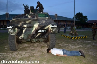 Hubby trying out planking under an army tank in the 73rd Infantry Battalion grounds in Sarangani