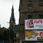 Such views are not uncommon in modern day Silesia. Church tower in the background, commercial ads in front.