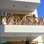 Emma and Lily are psyched to have a balcony and be in the warm beachside sun.of Paracas