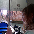 Safe under the umbrella in the thunder and rain, Venice canal.