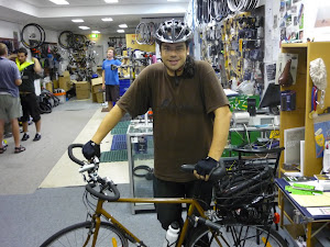 Peter's Crosscheck. Stock bike converted to Eurobars and MTB shifters. Nick demonstrates correct visibility procedure in the background.