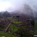 Wayna Picchu mysteriously shrounded in cloud behind Machu Picchu
