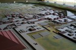 A model of Teotihuacan, with a fraction of the Pyramid of the Sun in lower left corner, Avenue of the Dead running across center and the Pyramid of the Moon in upper right corner.