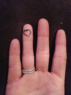 ring finger tattoos