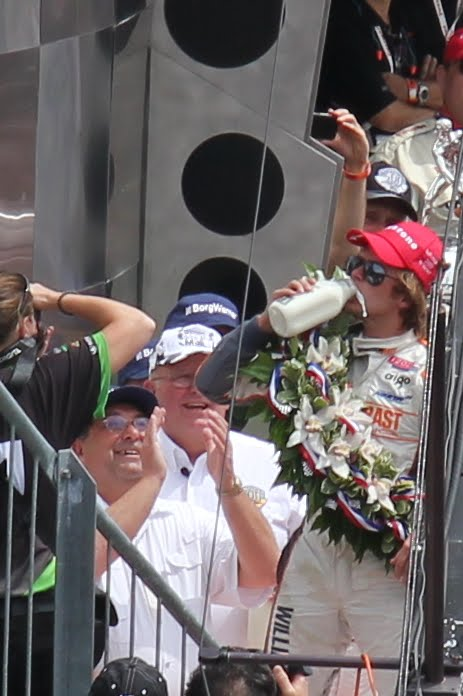 Dan Wheldon drinking the milk in Victory Circle after winning the 2011 Indy 500