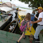 We board our narrow yellow boat with herman, our guide.