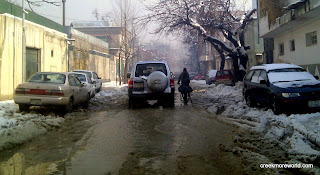 The streets are flooded with snow and slush.