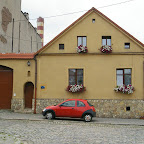 My Mother's car in front of one of many historic buildings in Chorzów Stary.