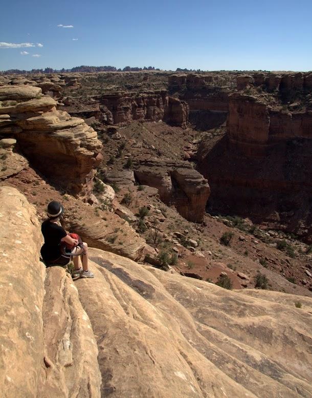Renee Relaxing on Canyon Edge.jpg