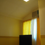 A perfect vision of our LCD TV inside our yellow-toned bedroom
